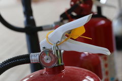 Fire extinguisher. Closeup of Fire extinguisher lever Royalty Free Stock Images
