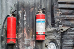 Fire extinguisher on corrugated wall Royalty Free Stock Photography