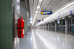 Fire extinguisher. In an empty corridor royalty free stock photography