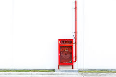 Fire extinguisher equipment on the white wall Royalty Free Stock Photography