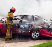 Fire extinguisher extinguishes a burning car from a fire hose, fire and auto stock photography