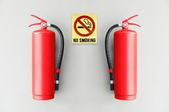 Fire extinguisher on the gray wall. Stock Photography