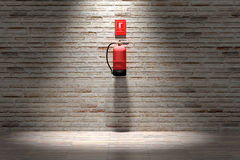 Fire extinguisher hanging on brick wall Stock Images