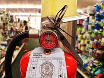 Fire extinguisher. A fire extinguisher hanging in a retail stor royalty free stock photography