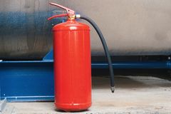 Fire extinguisher on industrial plant. Close up shot Stock Photography