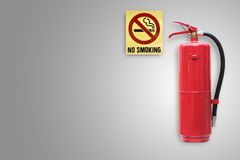 Fire extinguisher label on concrete wall with no smoking sign. Stock Photography
