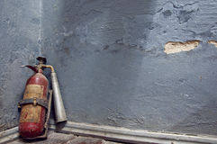 Fire extinguisher near  the wall Stock Images