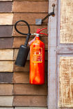 Fire extinguisher. Old Fire extinguisher on wooden wall stock image