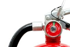 Fire extinguisher over white. Fire extinguisher fully charged. a highkey closeup over white with focus on pressure gauge Stock Photography