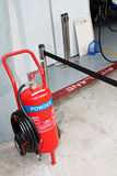 Fire extinguisher at pit stop vicinity Royalty Free Stock Photo