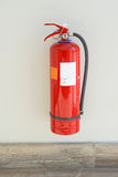 Fire extinguisher. Protectuion device at wall Royalty Free Stock Images