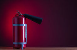 Fire extinguisher. On a red background stock photos
