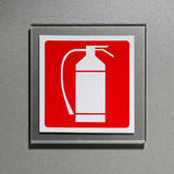 Fire extinguisher sign. On the office wall Stock Image