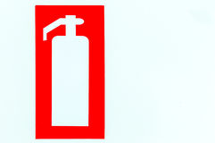 Fire extinguisher sign on the. Office wall Royalty Free Stock Photography
