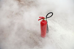 Fire Extinguisher with smoke Stock Images