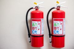 Fire extinguisher system on the wall background, powerful emergency equipment stock photos