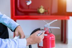 Fire extinguisher systems. Engineer inspection Fire extinguisher and fire hose stock photo
