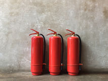 Fire Extinguisher. Three fire extinguishers in the corner Stock Photos