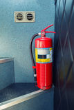 Fire extinguisher tools on the bus stair , Fire proof system, Tools equipment. Royalty Free Stock Image