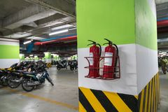 Fire extinguisher in underground basement motorbike parking Stock Photography