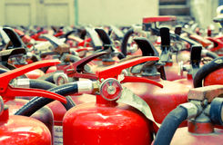 The fire extinguisher used. Background with a lot of fire extinguishers stock photo