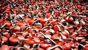 The fire extinguisher used. background with a lot of fire extinguishers. Close up of the fire extinguisher used (fire, tank, background royalty free stock images