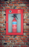 Fire extinguisher in wall box. brick wall Royalty Free Stock Photography