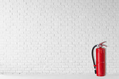 Fire extinguisher in white room Royalty Free Stock Photo