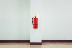 Fire extinguisher. On white wall, ready for use Stock Image