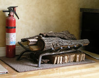 Fire Extinguisher and wood. In a home Royalty Free Stock Photos