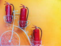 Fire extinguisher on the yellow wall. Fire extinguisher on the yellow wall Stock Image