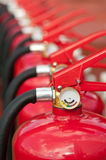 Fire extinguishers. Group of ready fire extinguishers for use Stock Image