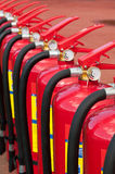 Fire extinguishers. Group of ready fire extinguishers for use Royalty Free Stock Images