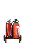 Fire Extinguishers. Two red fire extinguishers on a trolley with wheels and an alarm bell isolated over white Stock Photography