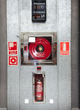 Fire extinguishers and Fire hydrants close up. Royalty Free Stock Photos