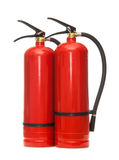 Fire extinguishers. New blank red fire extinguishers in closeup Royalty Free Stock Photo