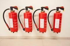 4 fire-extinguishers Royalty Free Stock Photo