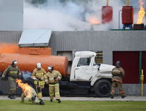 Fire extinguishing at the training ground of the Noginsk rescue center of the Ministry of Emergency Situations during the Internat. NOGINSK, RUSSIA - JUNE 6 Royalty Free Stock Images