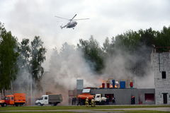 Fire extinguishing at the training ground of the Noginsk rescue center of the Ministry of Emergency Situations during the Internat. NOGINSK, RUSSIA - JUNE 6 Royalty Free Stock Photos
