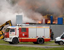 Fire extinguishing at the training ground of the Noginsk rescue center of the Ministry of Emergency Situations during the Internat. NOGINSK, RUSSIA - JUNE 6 Stock Photography