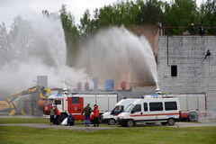 Fire extinguishing at the training ground of the Noginsk rescue center of the Ministry of Emergency Situations during. NOGINSK, RUSSIA - JUNE 6, 2017:Fire Stock Photography