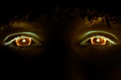 Fire eyes. Of a woman Stock Photography