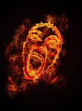 Fire face. Screaming face on fire on the black background Stock Photos