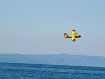 Fire fighter airplane in action Royalty Free Stock Photos