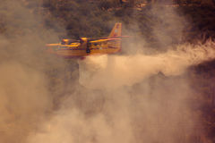 Fire fighter airplane, Greece. Fire fighter airplane in the sky over the forest, Zakynthos royalty free stock image