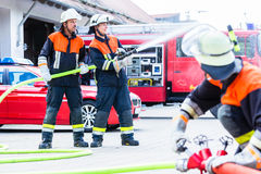 Free Fire Fighter Connecting Hoses Stock Photography - 86406282