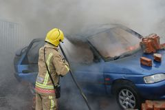 Fire fighter, car fire Royalty Free Stock Photos