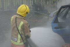 Fire fighter, car fire Stock Photos