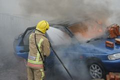 Fire fighter, car fire Stock Photo