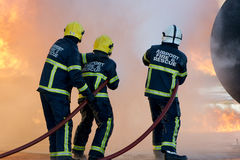 Fire-fighter fighting  fire Royalty Free Stock Photos